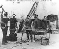 Navy blacksmiths        At work on the deck of a monitor, during the Civil War.      Note photographer's chest in the right background.      This ship has been identified as USS Lehigh, based on     information on National Archives' photog