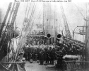 USS Kearsarge (1862-1894)        Ship's crew at their battle stations, shortly after her June     1864 action with CSS Alabama. View looks aft from the     forecastle, showing both XI-inch Dahlgren smoothbore cannon trained     to s